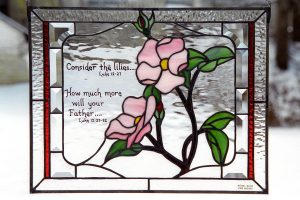 Stained glass with pink flowers and bible verse