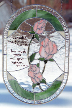 Stained glass panel with roses and bible verse