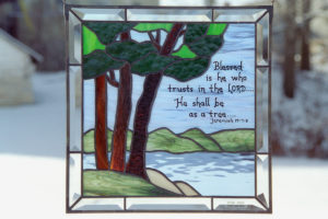 Stained glass with trees and bible scripture